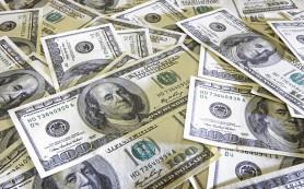Доллар ушел в минус на подорожавшей нефти