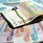 ЦБ РФ понизил на 20 февраля курс доллара до 62,13 рубля, курс евро - до 70,94 рубля