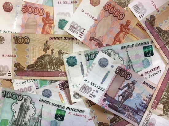 Рубль завершил основную валютную сессию укреплением к доллару и евро