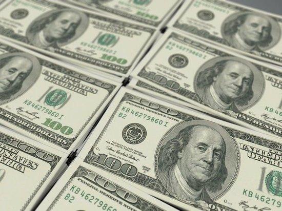 Курс доллара опустился ниже 71 рубля